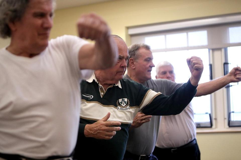 Plymouth, MA - 2/16/2018 - L to R: Paul MacDonald, 70, Bruce Goodwin, 73, Stuart Hudson, 71, and John Justice, 75, all Plymouth residents taking part in Uechi-Ryu Karate class at town's Center for Active Living. Towns are trying to attract baby boomers and younger seniors with martial arts and other such programs. - (Barry Chin/Globe Staff), Section: Business, Reporter: Unknown, Topic: xxseniorstigma, LOID: 8.4.1008843942.