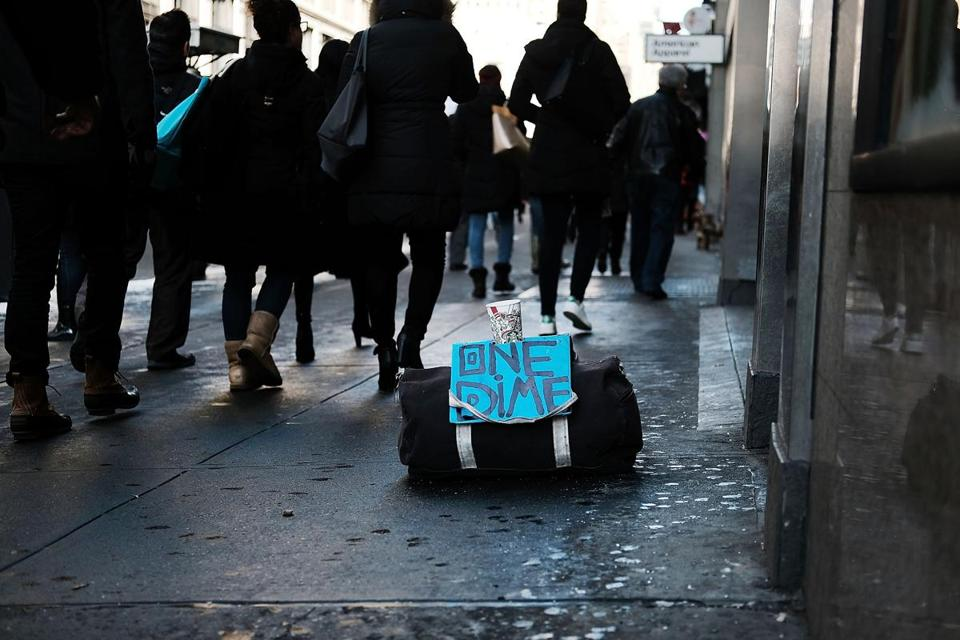 NEW YORK, NY - DECEMBER 14: A bag of a panhandler sits on a Manhattan street on December 14, 2017 in New York City. According to a new report released by the U.S. Department of Housing and Urban Development New York City's homeless population expanded by about 4 percent in 2017 as the number of homeless people nationwide grew to about 553,000. (Photo by Spencer Platt/Getty Images)