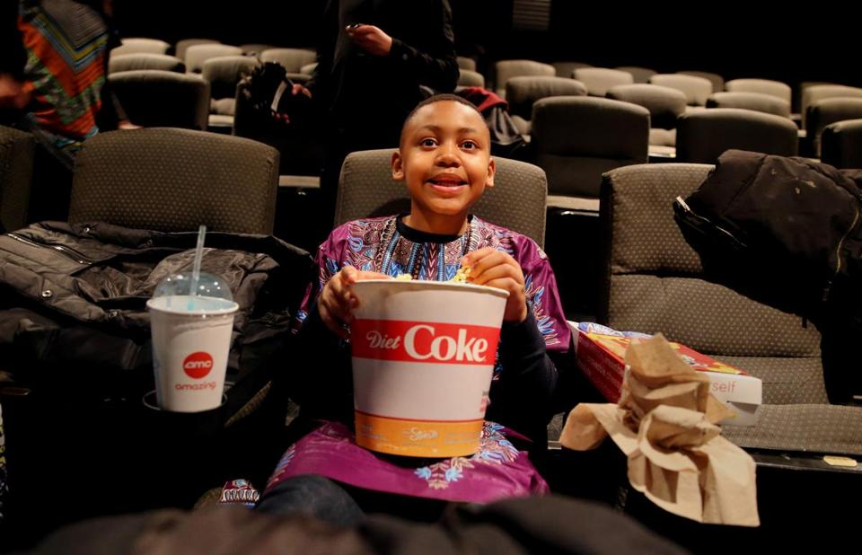 "Christopher Taylor, 9, said he was the first to be seated for a screening of ""Black Panther"" at AMC Loews Boston Common:"