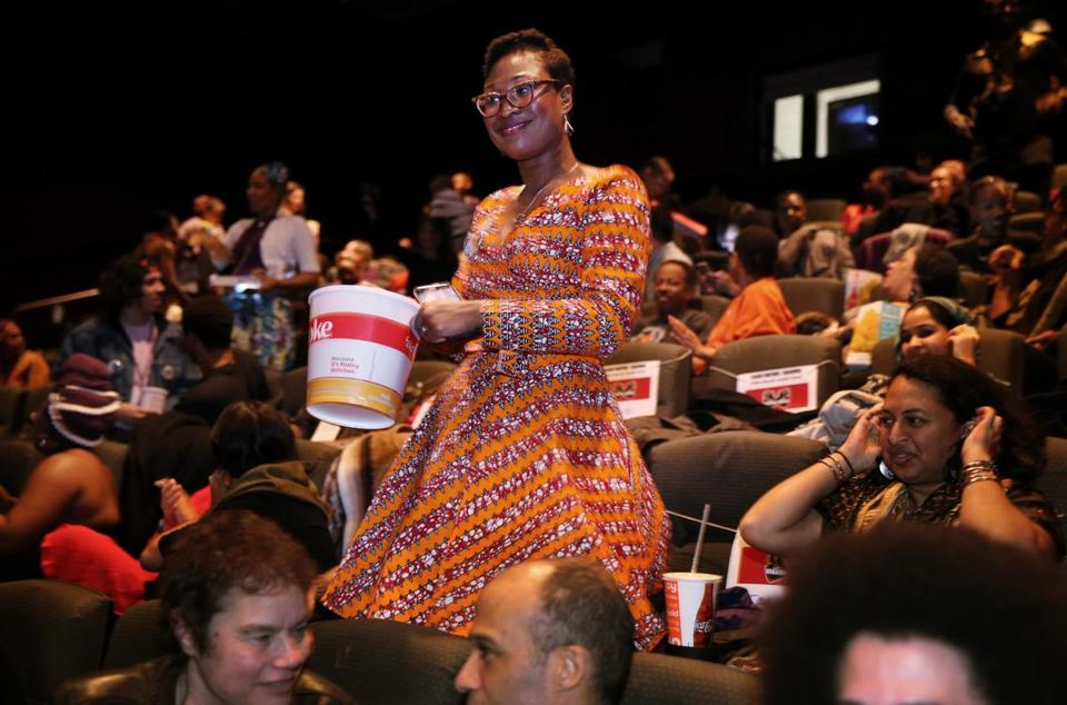 "Grace Beah danced while waiting to watch a screenings of ""Black Panther"" at AMC Loews Boston Common:"
