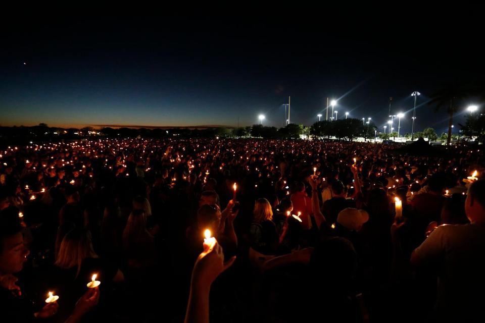 Thousands of mourners attend a candlelight vigil for victims of Marjory Stoneman Douglas High School shooting in Parkland, Florida on February 15, 2018. A former student, Nikolas Cruz, opened fire at the Florida high school leaving 17 people dead and 15 injured. / AFP PHOTO / RHONA WISERHONA WISE/AFP/Getty Images