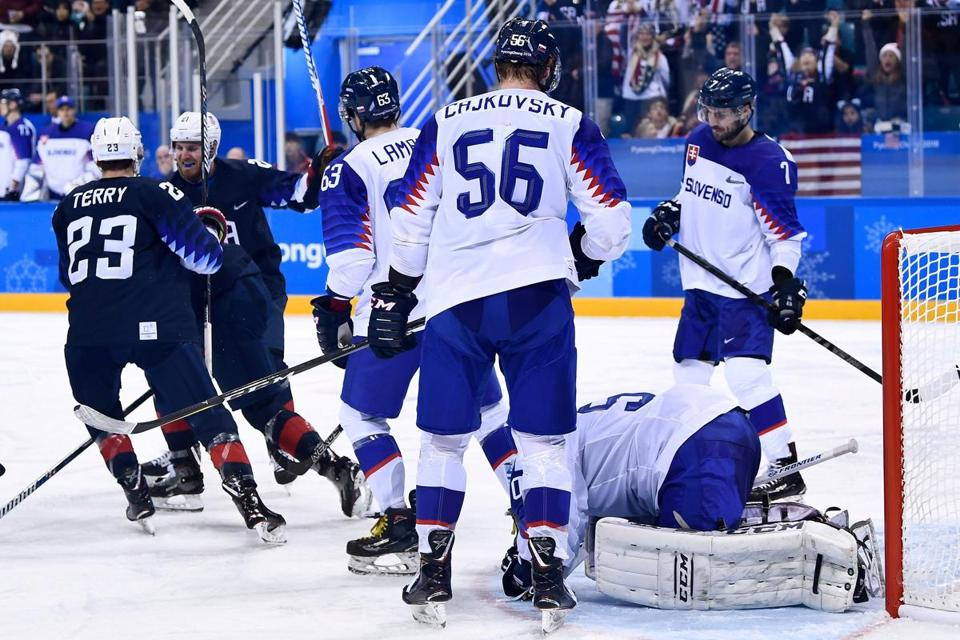 The US team celebrates a goal in the men's preliminary round ice hockey match between the US and Slovakia during the Pyeongchang 2018 Winter Olympic Games at the Gangneung Hockey Centre in Gangneung on February 16, 2018. / AFP PHOTO / Brendan SmialowskiBRENDAN SMIALOWSKI/AFP/Getty Images