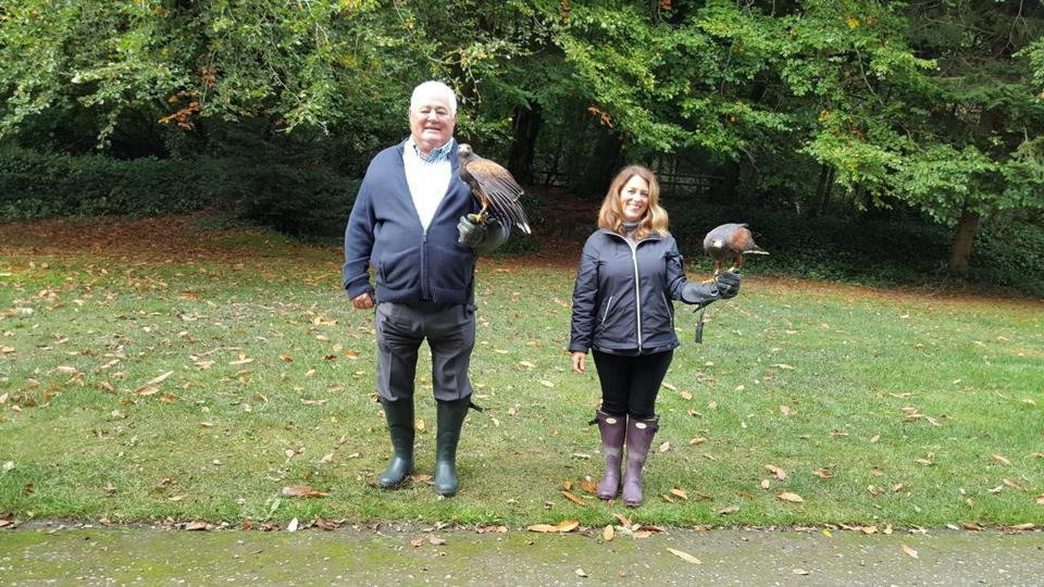 The writer and her father with their feathered friends at Ireland's School of Falconry at Ashford Castle.