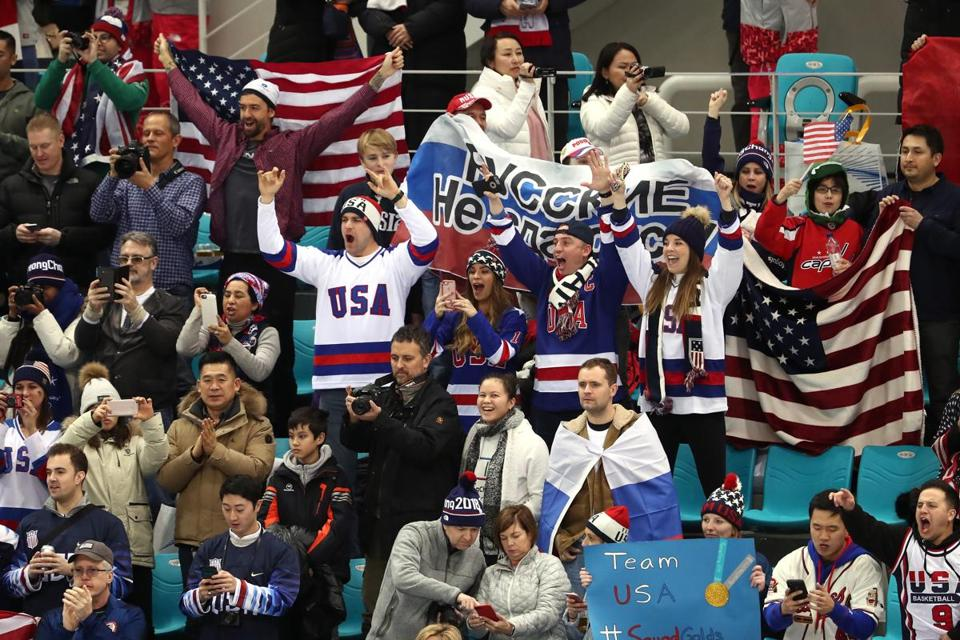GANGNEUNG, SOUTH KOREA - FEBRUARY 17: Fans of the United States cheer prior to the Men's Ice Hockey Preliminary Round Group B game against Olympic Athlete from Russia on day eight of the PyeongChang 2018 Winter Olympic Games at Gangneung Hockey Centre on February 17, 2018 in Gangneung, South Korea. (Photo by Ronald Martinez/Getty Images)