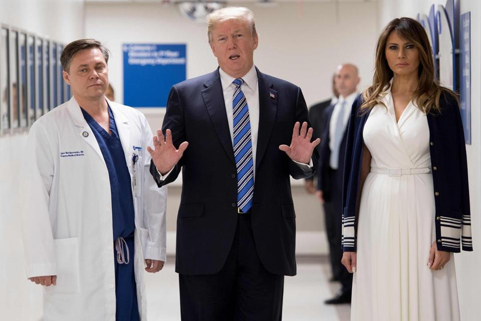US President Donald Trump speaks with doctor Igor Nichiphorenko (L) and First Lady Melania Trump while visiting first responders at Broward Health North hospital Pompano Beach, Florida, on Februar US President Donald Trump and First Lady Melania Trump visited a Florida hospital to offer their respects to the victims of a mass shooting that claimed 17 lives at a nearby high school. / AFP PHOTO / JIM WATSONJIM WATSON/AFP/Getty Images