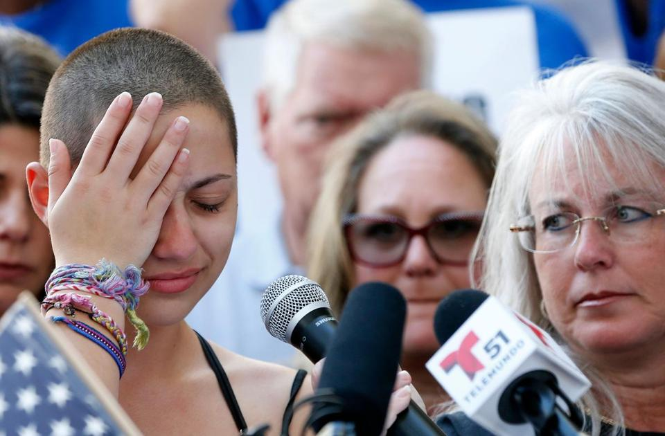"TOPSHOT - Marjory Stoneman Douglas High School student Emma Gonzalez reacts during her speech at a rally for gun control at the Broward County Federal Courthouse in Fort Lauderdale, Florida on February 17, 2018. A student survivor of the Parkland school shooting called out US President Donald Trump on Saturday over his ties to the powerful National Rifle Association, in a poignant address to an anti-gun rally in Florida. ""To every politician taking donations from the NRA, shame on you!"" said Emma Gonzalez, assailing Trump over the multi-million-dollar support his campaign received from the gun lobby -- and prompting the crowd to chant in turn: ""Shame on you!"" / AFP PHOTO / RHONA WISERHONA WISE/AFP/Getty Images"