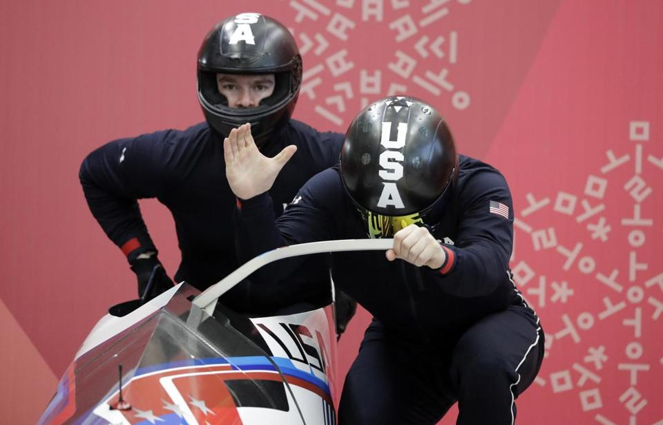 Driver Codie Bascue and Samuel McGuffie of the United States prepare to start a run during the two-man bobsled training at the 2018 Winter Olympics in Pyeongchang, South Korea, Friday, Feb. 16, 2018. (AP Photo/Wong Maye-E)