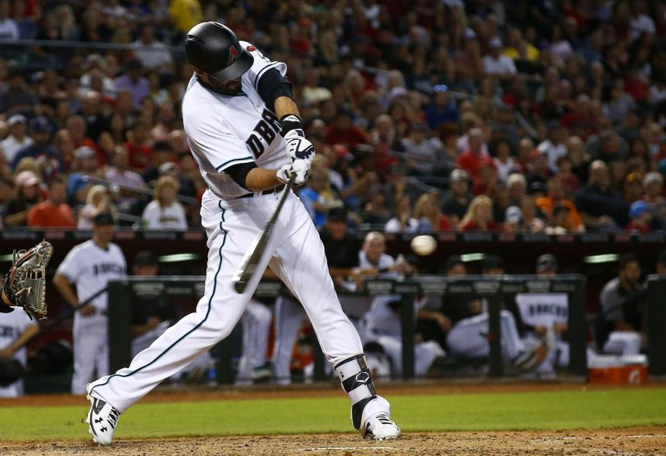 Arizona Diamondbacks' J.D. Martinez connects for a two-run home run against the San Diego Padres during the sixth inning of a baseball game Friday, Sept. 8, 2017, in Phoenix. (AP Photo/Ross D. Franklin)