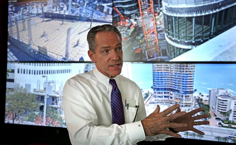 Live feeds of Suffolk Construction's projects around the country appeared on screens behind CEO John Fish.