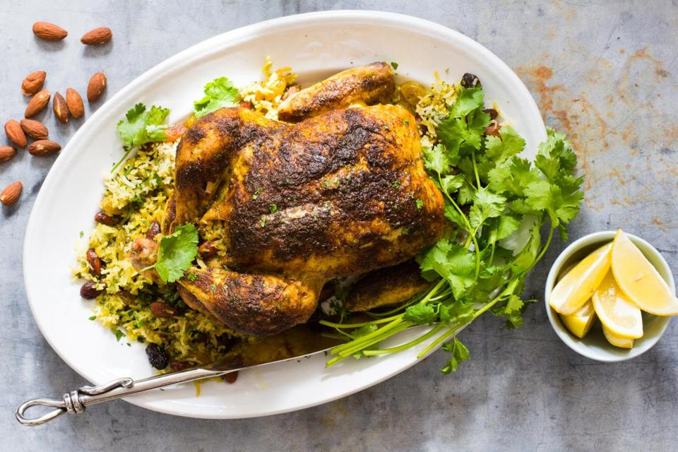 Spicy whole chicken stuffed with rice pilaf