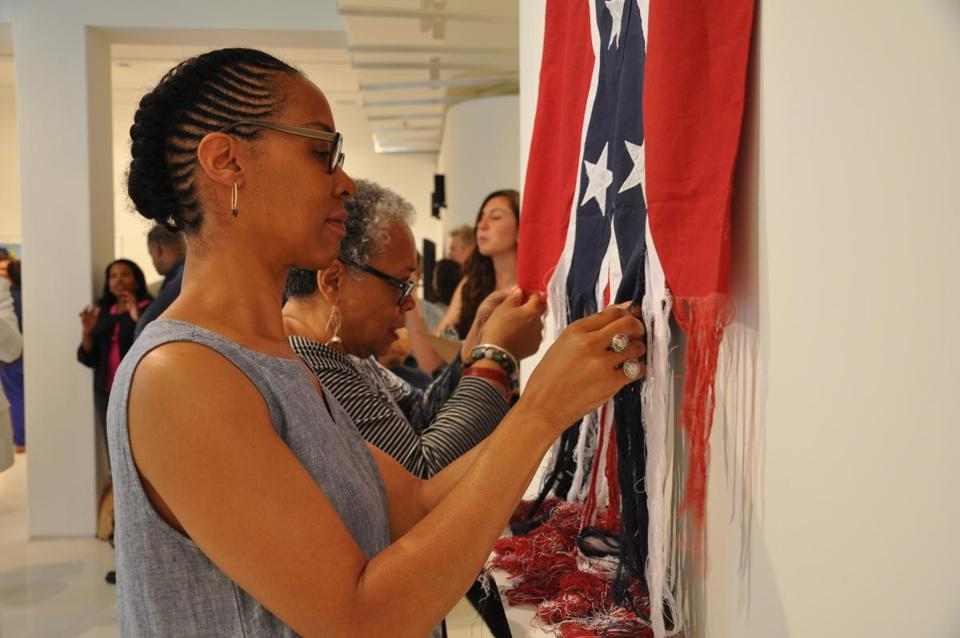 "22confederateflag -- Sonya Clark has performed ""Unraveling"" in several cities already. People are invited to participate in this performance by working side-by-side with the artist to unravel threads of the Confederate Battle flag. (Handout)"