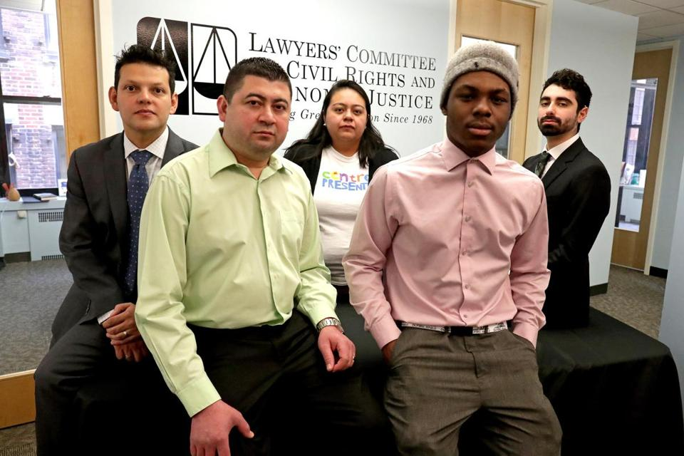 Boston, MA - 2/22/2018 - Lawyers' Committee for Civil Rights and Economic Justice will be filing lawsuit on behalf of Salvadoran and Haitian TPS recipients. L to R: Back row, Ivan Espinoza, Exec. Dir. Jennifer Hernandez, Immigrant Right's Organizer Centro Presente, and Oren Nimni. Front row: Juan Carlos Vidal, a plaintiff in the suit from El Salvador and Chris Jean Baptiste, a plaintiff from Haiti, at the offices of Lawyers' Committee for Civil Rights and Economic Justice. - (Barry Chin/Globe Staff), Section: Metro, Reporter: Karl Capen, Topic: 23tpssuit, LOID: 8.4.1080204839.