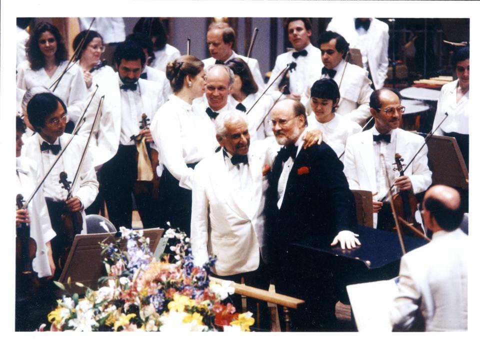 Five Pops concerts in May will consist of compositions by Leonard Bernstein (center left, with John Williams in 1989). Also in May, Williams will return to lead his traditional film night.