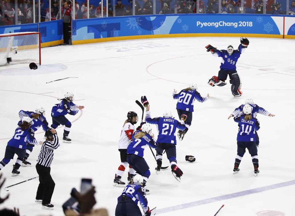 United States celebrates winning the women's gold medal hockey game against Canada at the 2018 Winter Olympics in Gangneung, South Korea, Thursday, Feb. 22, 2018. (AP Photo/Jae C. Hong)