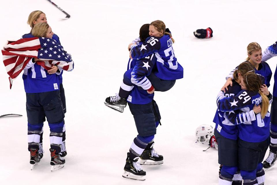 GANGNEUNG, SOUTH KOREA - FEBRUARY 22: Hilary Knight #21 hugs Kendall Coyne #26 of the United States after defeating Canada in overtime to win the Women's Gold Medal Game on day thirteen of the PyeongChang 2018 Winter Olympic Games at Gangneung Hockey Centre on February 22, 2018 in Gangneung, South Korea. (Photo by Harry How/Getty Images)