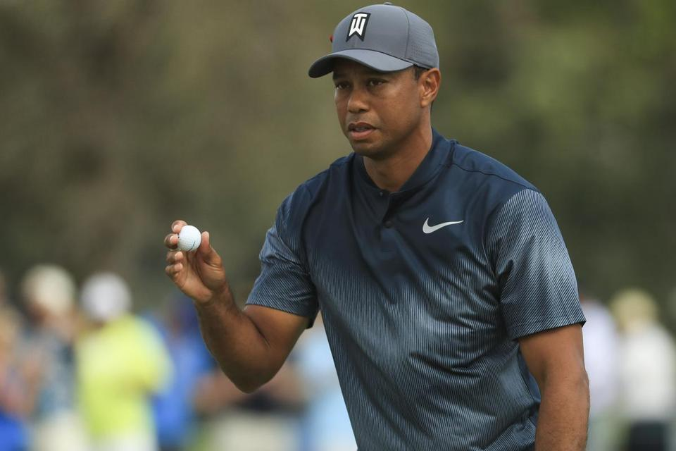 PALM BEACH GARDENS, FL - FEBRUARY 22: Tiger Woods reacts after a putt on the fifth green during the first round of the Honda Classic at PGA National Resort and Spa on February 22, 2018 in Palm Beach Gardens, Florida. (Photo by Mike Ehrmann/Getty Images)
