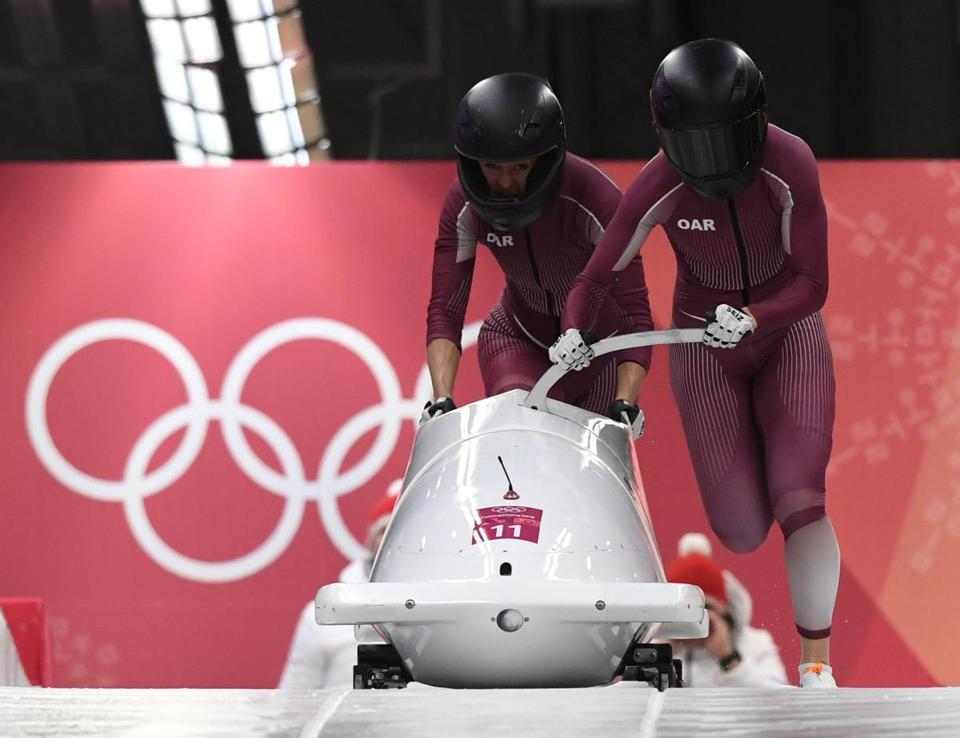 Russia's Nadezhda Sergeeva (R) and Russia's Anastasia Kocherzhova compete in the women's bobsleigh heat 1 run during the Pyeongchang 2018 Winter Olympic Games, at the Olympic Sliding Centre on February 20, 2018 in Pyeongchang. / AFP PHOTO / Mark RalstonMARK RALSTON/AFP/Getty Images