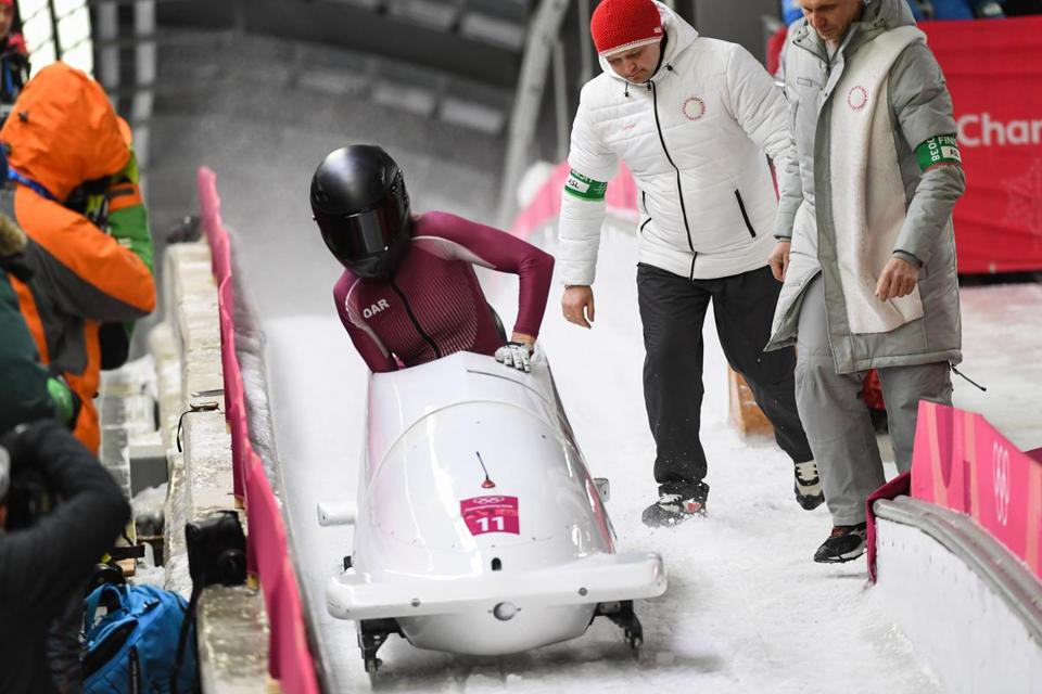 (FILES) In this file photo taken on February 21, 2018 Russia's Nadezhda Sergeeva and Russia's Anastasia Kocherzhova (unseen) compete in the women's bobsleigh heat 4 final run during the Pyeongchang 2018 Winter Olympic Games at the Olympic Sliding Centre on February 21, 2018 in Pyeongchang. Russian bobsledder Nadezhda Sergeeva has tested positive for a banned substance at the Winter Olympics, Russia's bobsleigh federation said February 23, 2018. / AFP PHOTO / Mark RALSTONMARK RALSTON/AFP/Getty Images