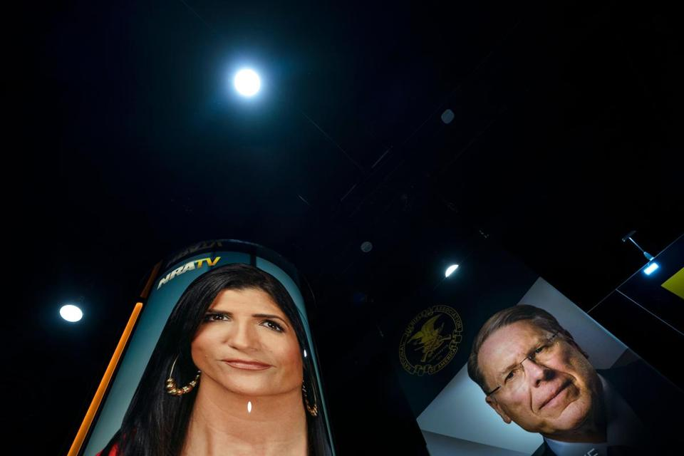 Photographs of NRA spokeswoman Dana Loesch (left) and NRA executive vice president and CEO Wayne LaPierre were posted in the vendors area of the 45th annual Conservative Political Action Conference.