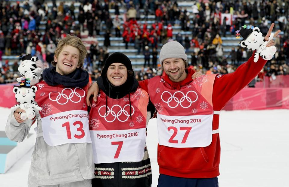 Gold medal winner Sebastien Toutant, of Canada, is flanked by silver medal winner Kyle Mack, of the United States, left, and bronze medal winner Billy Morgan, of Great Britain, during the venue ceremony for the men's Big Air snowboard competition at the 2018 Winter Olympics in Pyeongchang, South Korea, Saturday, Feb. 24, 2018. (AP Photo/Kirsty Wigglesworth)