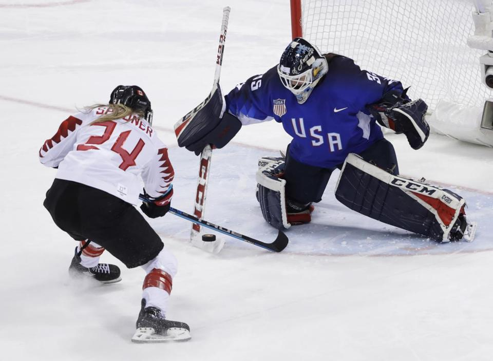 Goalie Maddie Rooney (35), of the United States, blocks a shot by Natalie Spooner (24), of Canada, in the penalty shootout during the women's gold medal hockey game at the 2018 Winter Olympics in Gangneung, South Korea, Thursday, Feb. 22, 2018. (AP Photo/Matt Slocum)
