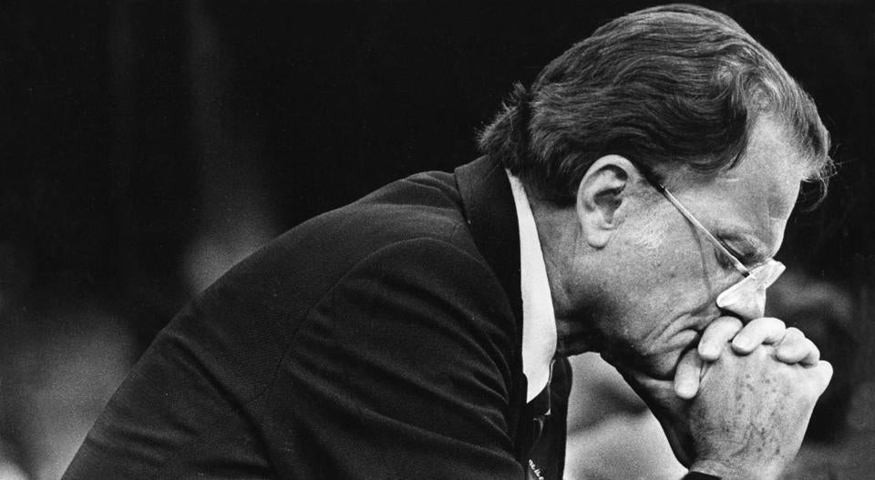 Rev. Billy Graham prays during a service memorial in Baltimore on June 10, 1981. MUST CREDIT: Washington Post photo by Lucian Perkins