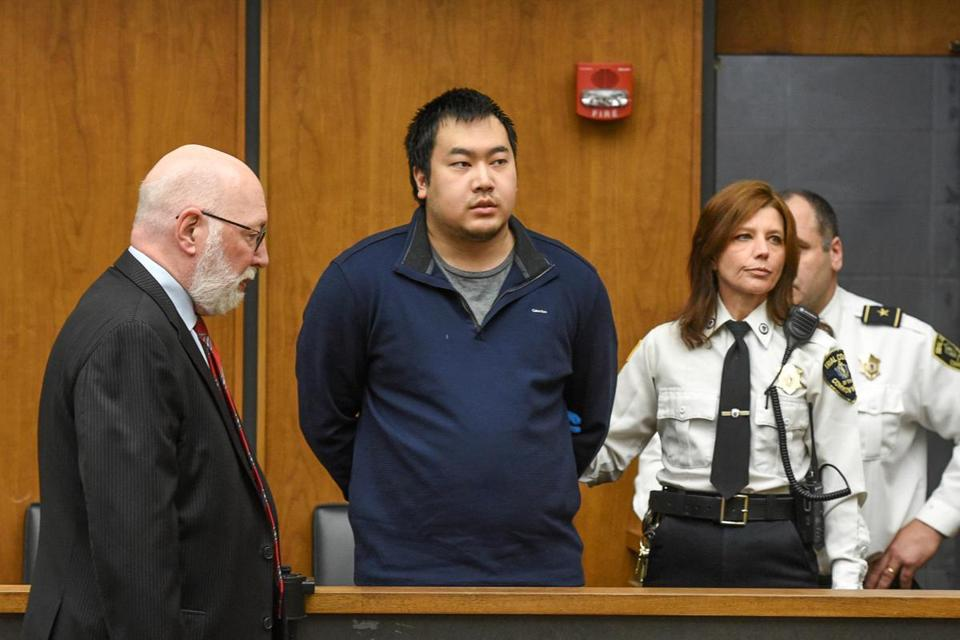 ( 02/26/18 Woburn, MA) Jeffrey Yao appears with his lawyer, J.W. Carney, Jr. during his arraignment in Woburn District Court on murder charges and attempted murder after allegedly stabbing a woman to death and attempting to stab a man to death in the Winchester Public Library. (Faith Ninivaggi/POOL)
