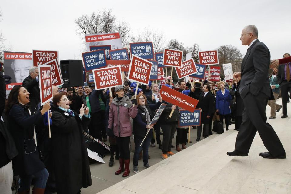 Supporters of Illinois government employee Mark Janus cheer as he walks to thank them, outside the Supreme Court, Monday, Feb. 26, 2018, in Washington. The Supreme Court takes up a challenge Monday in a case that could deal a painful financial blow to organized labor. The court is considering a challenge to an Illinois law that allows unions representing government employees to collect fees from workers who choose not to join. (AP Photo/Jacquelyn Martin)
