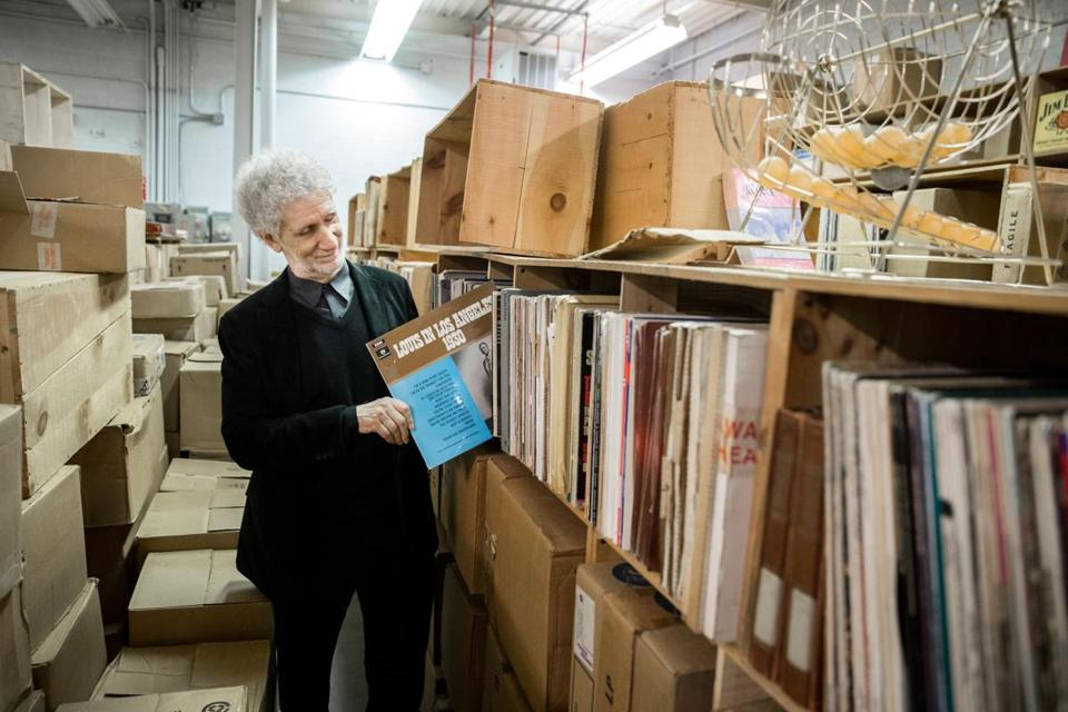 02/25/2018 NORWOOD, MA David Bieber (cq) goes through vinyl albums at his archives at the Norwood Space Center. (Aram Boghosian for The Boston Globe)