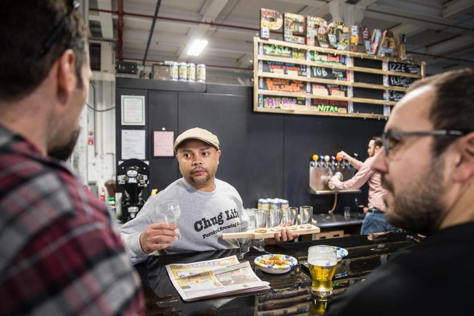 02/25/2018 NORWOOD, MA Owner Felipe Oliveira (cq) pours draft beer for customers at Percival Brewing Co. in the Norwood Space Center. (Aram Boghosian for The Boston Globe)