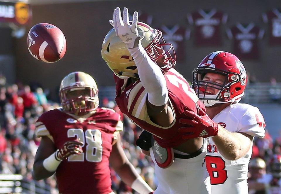 Boston-11/11/17- BC vs NC State- BC's Lukas Denis knocks the long pass away from NC State's receiver Cole Brook near the end zone in the 2nd qtr. John Tlumacki/Globe Staff(sports)