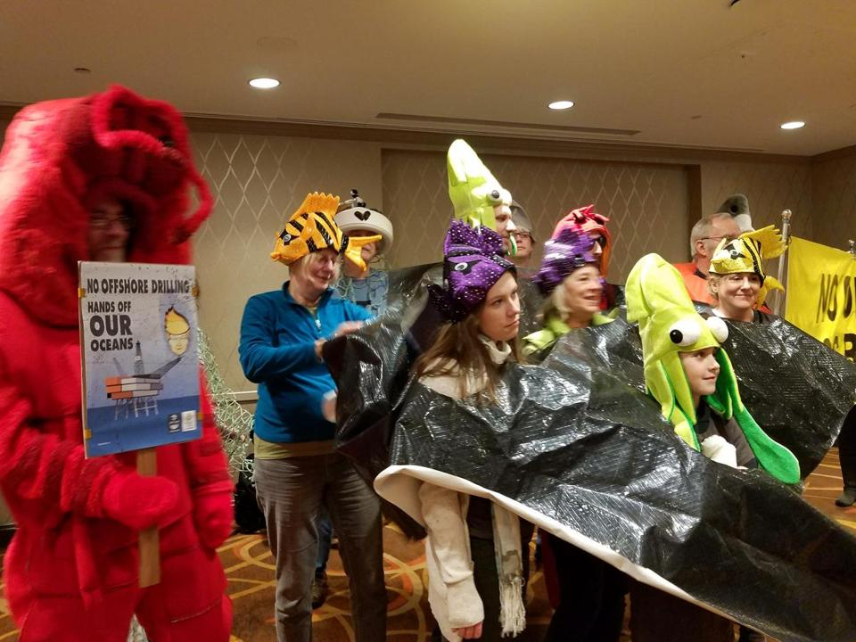02offshore -- Protesters gathered at the Sheraton Hotel in Boston to denounce a plan by the Trump Administration to drill for oil and gas in the waters off New England. (David Abel/Globe Staff)