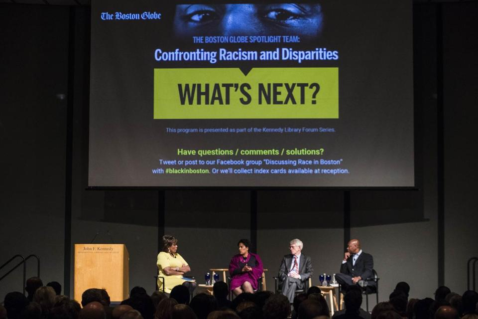 Liz Walker(left) spoke with NAACP Boston Branch President Tanisha Sullivan, Massport CEO Tom Glynn, and developer Darryl Settles during a panel to discuss the Boston Globe Spotlight Team's series on race at the JFK Memorial Library in Boston on Feb. 27.