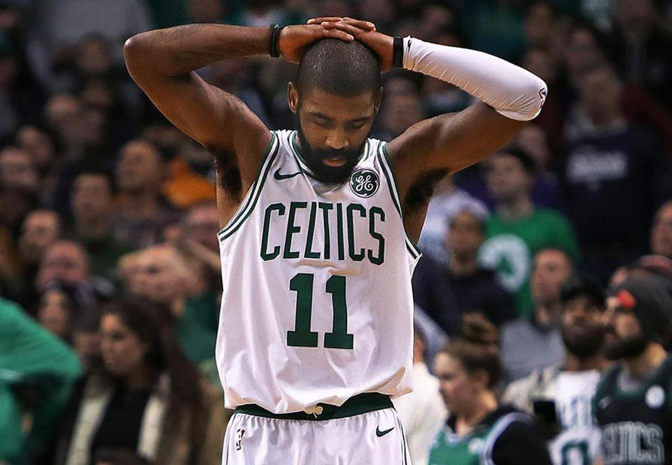 Boston, MA 1-16-18: With New Orleans leading 116-113 in overtime, the Celtics Kyrie Irving tried to tie the game with a three point attempt with under five seconds left, but he is pictured reacting after he missed the shot and the Pelicans had the victory. The Boston Celtics hosted the New Orleans Pelicans in an NBA regular season basketball game at the TD Garden. (Jim Davis/Globe Staff)