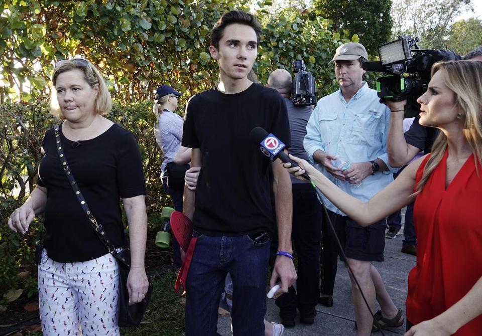 Student David Hogg speaks to the media as he returns to Marjory Stoneman Douglas High School in Parkland, Fla., Wednesday.