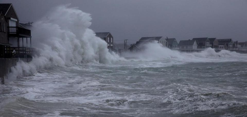 Waves crashed against the seawall along Turner Road in Scituate.
