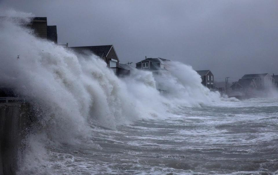 Waves crashed against the seawall along Turner Road in Scituate on Friday.
