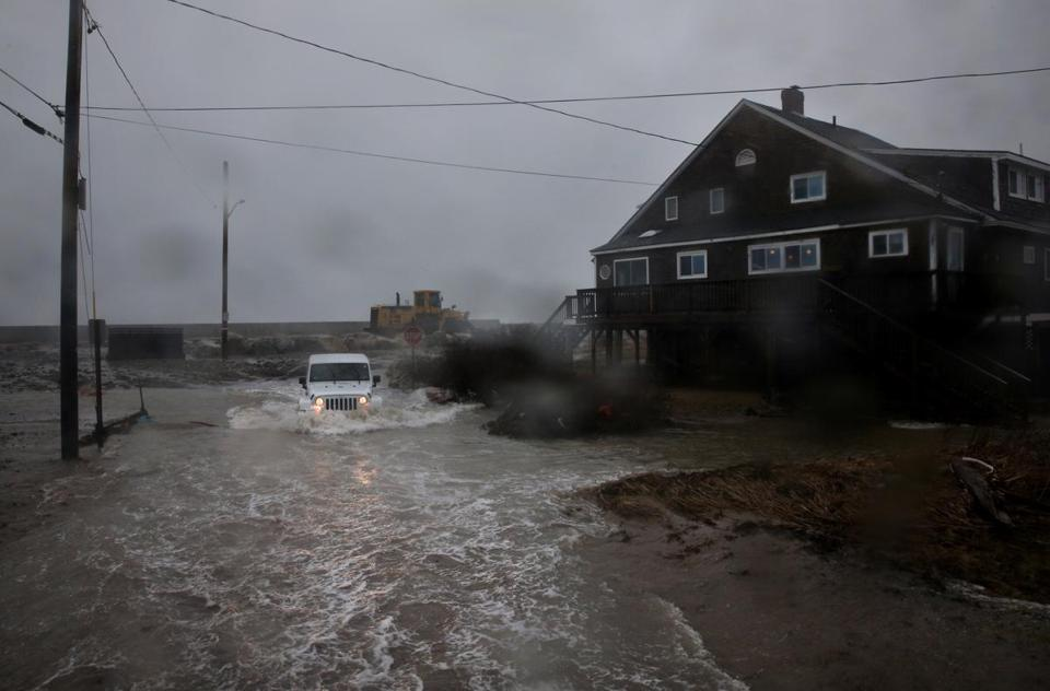 Scituate, MA- March 02, 2018: Oceanside Drive resident Kate McRoberts passes through a flooded Kenneth Rd in Scituate, MA during the nor'easter on March 02, 2018. Powerful winds, rain, and some snow moved into Mass. Friday as part of a weather system that has prompted voluntary evacuations and sandbagging near a downtown T stop. (Craig F. Walker/Globe Staff) section: metro reporter: