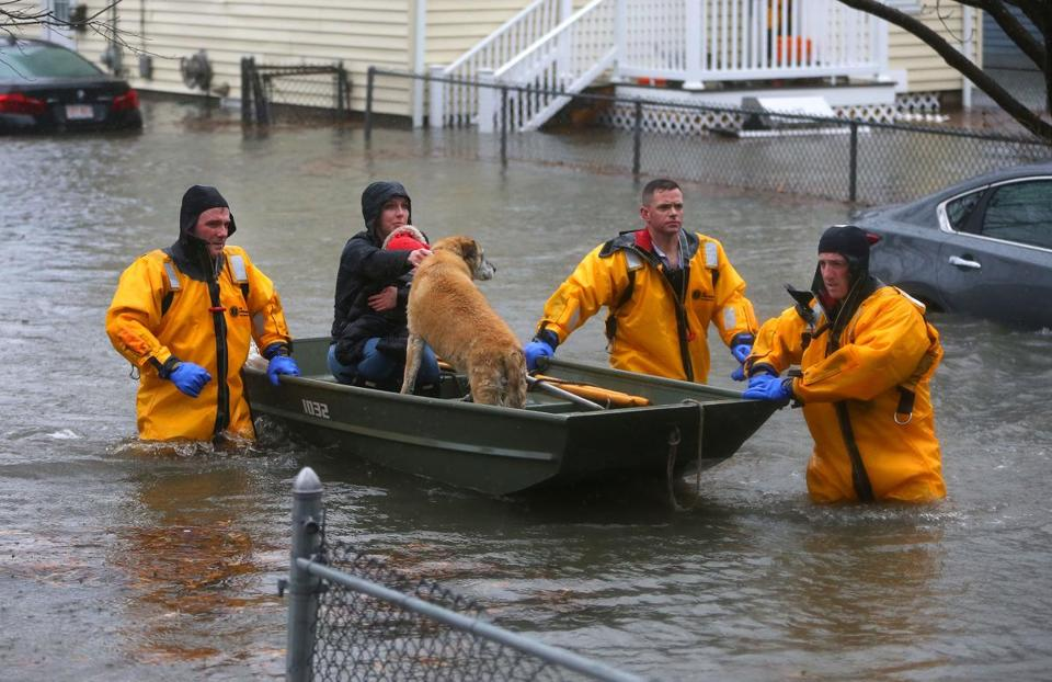 A mother, child, and dog were rescued from a flooded home on Post Island Road in Quincy on Friday.