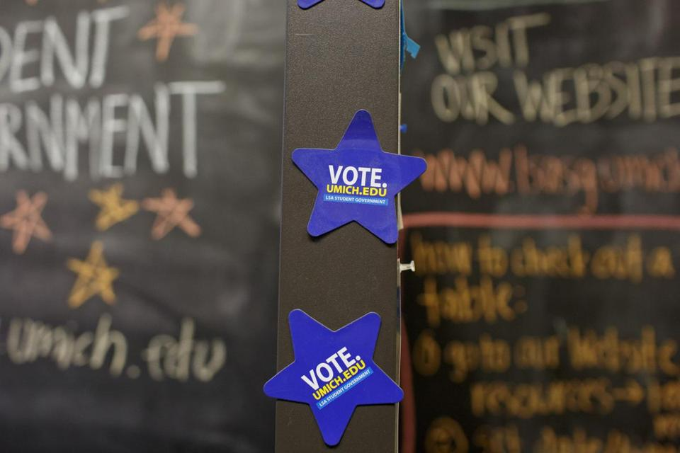 "Student government voting magnets in Mason Hall during a ""Bagels and Ballots"" event at the University of Michigan in Ann Arbor last month."