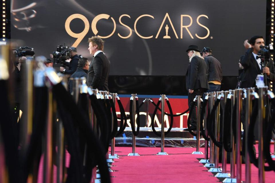 "TV crews rehearse and get ready on the red carpet a few hours before the ""Oscars"", the 90th Annual Academy Awards on March 4, 2018, in Hollywood, California. / AFP PHOTO / Robyn BeckROBYN BECK/AFP/Getty Images"