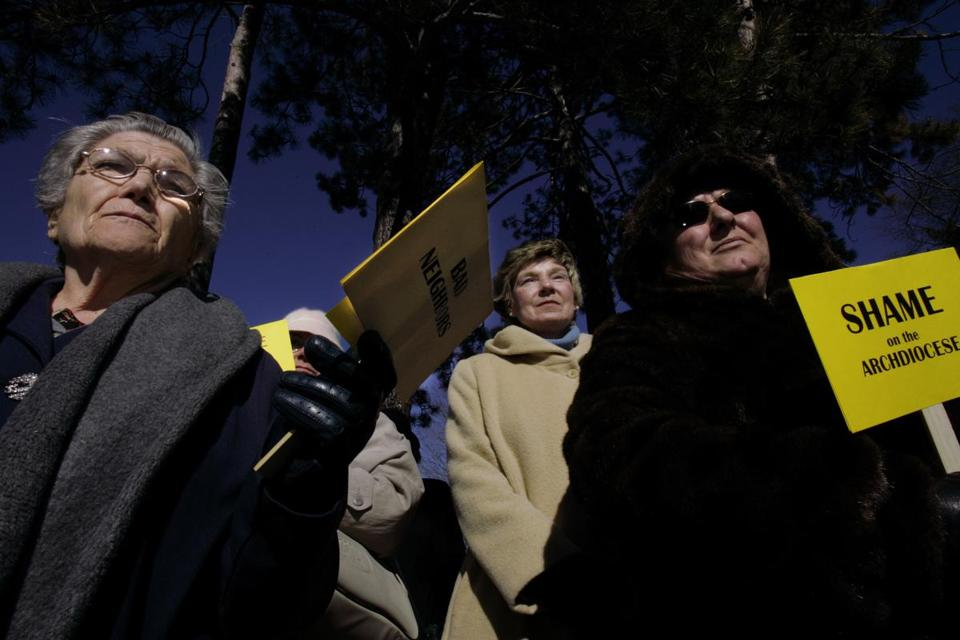 Giovanna Rosapane (left) and Maura Hennigan (center) joined Mrs. Scalcione during a protest outside of The Archdiocese of Boston in 2005. Mrs. Scalcione was a founder of the Gove Street Citizens Association.