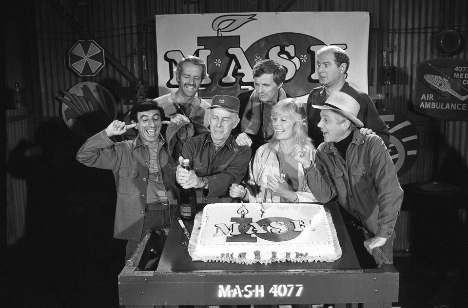 "Cast members, including Mr. Stiers (rear right), celebrated the 10th season of ""M*A*S*H,"" a comedy-drama about a team of doctors and support staff during the Korean War."