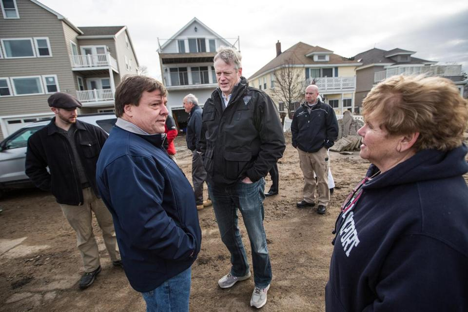 Governor Charlie Baker walked with Mayor Thomas Koch along Post Island Road in Quincy that was heavily damaged by flooding from the recent storm.