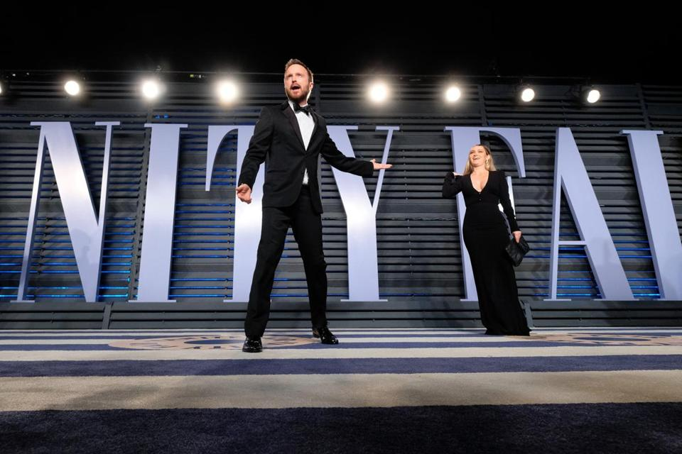 Aaron Paul (left) and Lauren Parsekian were among those at Vanity Fair's post-Oscars bash.