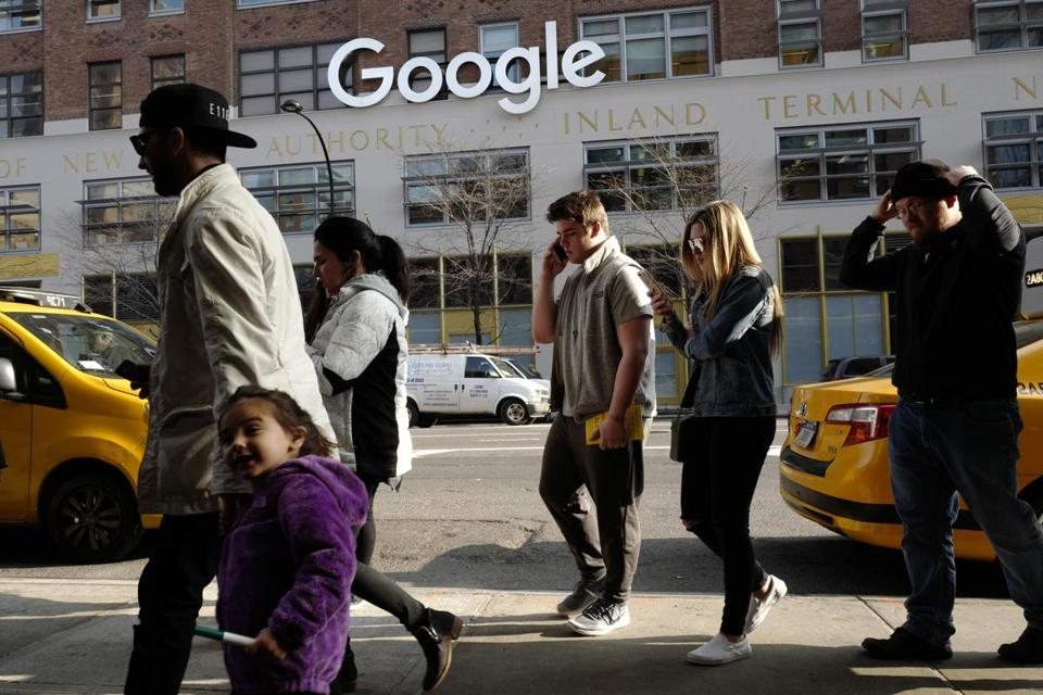 Google has been quietly expanding its footprint in America's biggest city. Above: Pedestrians walked by Google's Manhattan building.