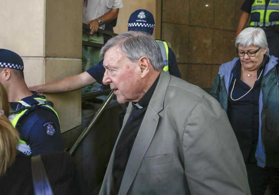 Cardinal George Pell (center) left a Melboune court after Monday's hearing.
