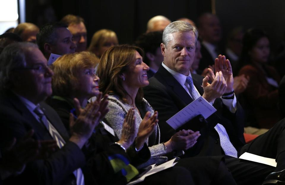 Governor Baker (right) applauded before the start of UMass president Martin T. Meehan's State of the University speech on Monday night.