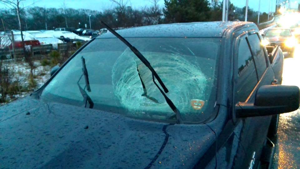 The windshields of three vehicles were broken by falling ice on the Sagamore Bridge on Monday, police said.
