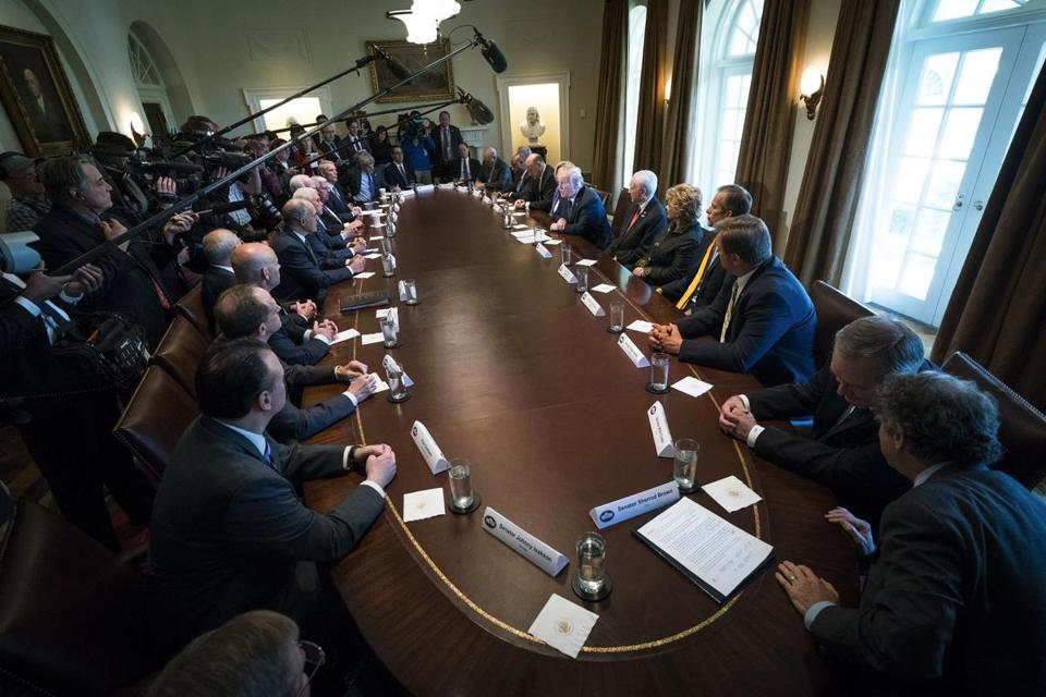 President Donald Trump and staff met with members of the Senate Finance Committee in the Cabinet Room of the White House in  October.